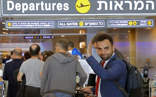 American citizen Omar Shakir, the director of the New York-based Human Rights Watch for Israel, the West Bank and Gaza,, waves ahead of entering the departures area at Ben Gurion Airport on November 25, 2019, after being expelled from Israel. (Photo by JACK GUEZ / AFP)