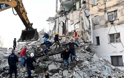 Emergency workers clear debris at a damaged building in Thumane, 34 kilometers northwest of capital Tirana, after an earthquake hit Albania, on November 26, 2019. (Gent SHKULLAKU / AFP)