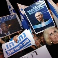 Illustrative: Supporters of Prime Minister Benjamin Netanyahu at a rally held under the banner 'Protesting the coup' in Tel Aviv, on November 26, 2019. (Jack Guez/AFP)