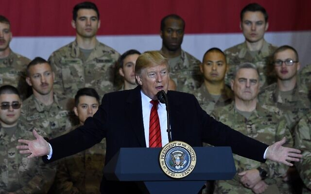 US President Donald Trump speaks to the troops during a surprise Thanksgiving day visit at Bagram Air Field, on November 28, 2019, in Afghanistan. (Olivier Douliery / AFP)
