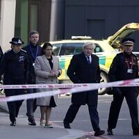 Britain's Prime Minister Boris Johnson, Britain's Home Secretary Priti Patel, Metropolitan Police Commissioner Cressida Dick, second left, and Commissioner of the City of London Police, Ian Dyson, right, arrive at the scene of a stabbing on London Bridge in the City of London, on November 30, 2019. (Photo by Niklas HALLE'N / AFP)