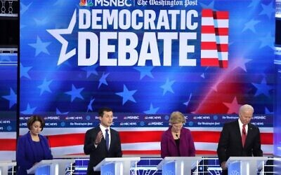 Democratic presidential candidate Sen. Amy Klobuchar (D-MN) (L) South Bend, Indiana Mayor Pete Buttigieg, Sen. Elizabeth Warren (D-MA) and former Vice President Joe Biden participate in the Democratic Presidential Debate at Tyler Perry Studios November 20, 2019 in Atlanta, Georgia. Ten Democratic presidential hopefuls were chosen from the larger field of candidates to participate in the debate hosted by MSNBC and The Washington Post.   (Alex Wong/Getty Images/AFP)