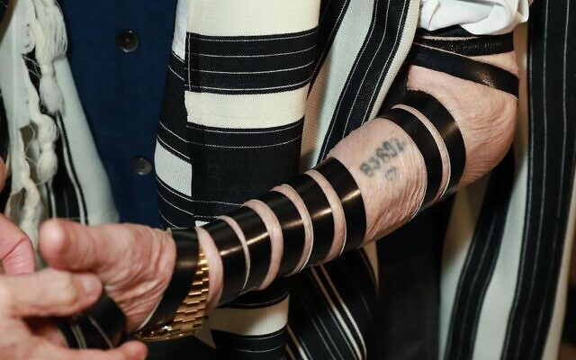 Andor Stern's concentration camp tattoo is seen despite his tefillin straps. (Courtesy of the Sao Paulo Holocaust Memorial via JTA)