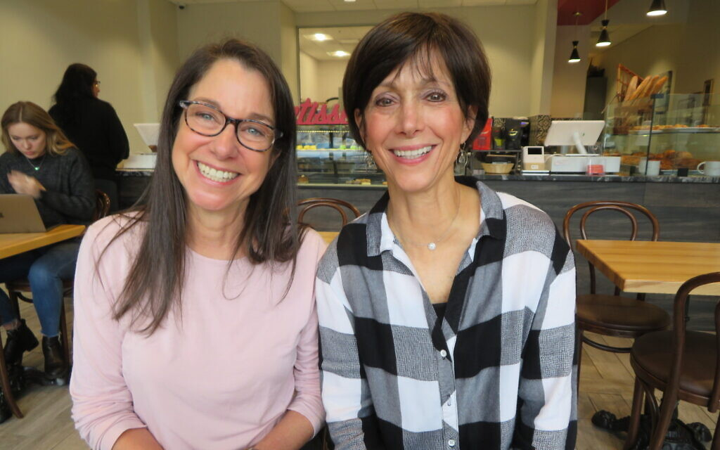 Valerie Habif, left, and Joanie Shubin, who founded the Jewish Democratic Women's Salon in Atlanta, pose in a cafe in Sandy Springs, a suburb of Atlanta, November 22, 2019. (Ron Kampeas/JTA)