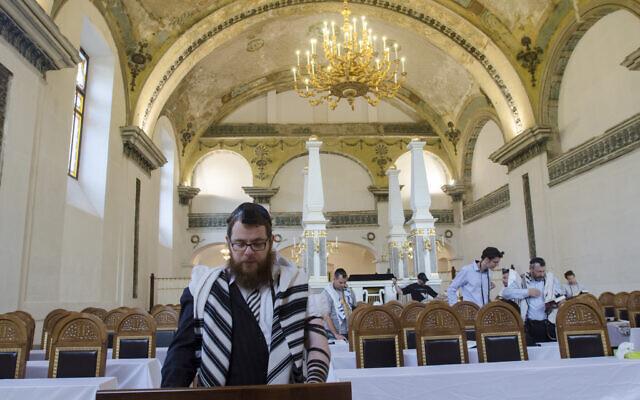 Rabbi Shlomo Koves, left, praying at his Obuda Synagogue in Budapest, Hungary on October 7, 2019. (Courtesy of EMIH/via JTA)