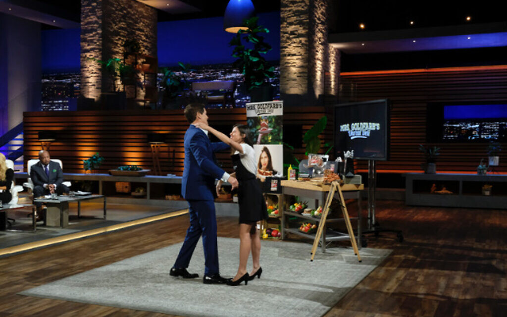 Native New Yorker Jenny Goldfarb, who now lives in Los Angeles, California, hugs Mark Cuban on 'Shark Tank,' Sunday, November 17, 2019. (ABC/Jessica Brooks)