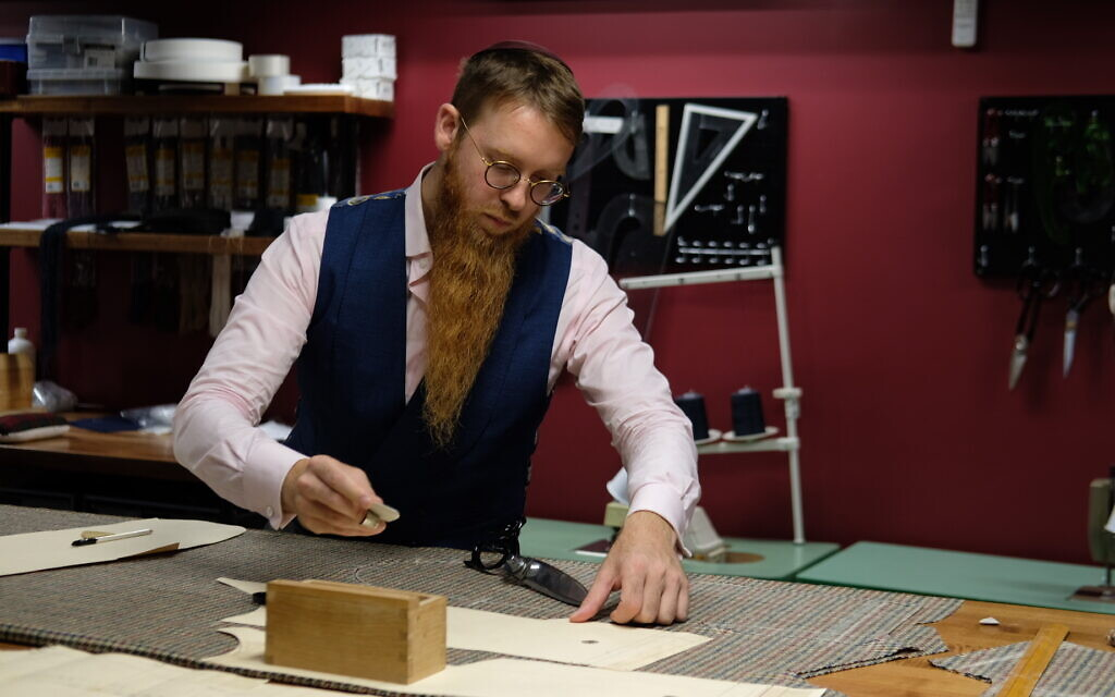 Yosel Tiefenbrun works at his bespoke tailoring house in Williamsburg, Brooklyn. (Courtesy of Tiefenbrun)