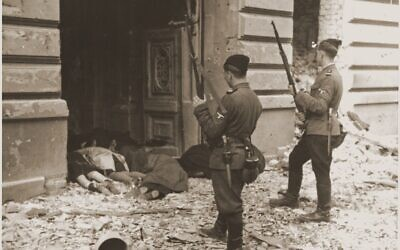 Askari or Trawniki guards peer into a doorway past the bodies of Jews killed during the suppression of the Warsaw   ghetto uprising. (Courtesy of US Holocaust Memorial Museum)