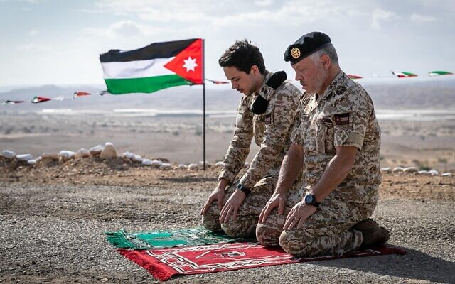 Jordan's King Abdullah II and Crown Prince Hussein pray at the Tzofar enclave after the return of the territory from Israel, November 16, 2019 (Courtesy)
