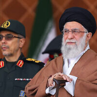 Iranian Supreme Leader Ayatollah Ali Khamenei, right, reviews armed forces with Chief of the General Staff of the Armed Forces Gen. Mohammad Hossein Bagheri, during a graduation ceremony at Iran's Air Defense Academy, in Tehran, Iran, October 30, 2019. (Office of the Iranian Supreme Leader via AP)