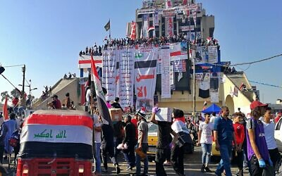 Anti-government protesters gather in Tahrir Square during ongoing protests in Baghdad, Iraq, Friday, Nov. 1, 2019. (AP Photo/Khalid Mohammed)
