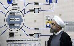 In this January 13, 2015, file photo released by the Iranian President's Office, President Hassan Rouhani visits the Bushehr nuclear power plant just outside of Bushehr, Iran (AP Photo/Iranian Presidency Office, Mohammad Berno)