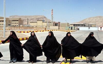 In this Aug. 16, 2005 file photo, Iranian women form a human chain, at the Isfahan Uranium Conversion Facility, in support of Iran's nuclear program, just outside the city of Isfahan, Iran (AP Photo/Vahid Salemi)