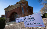Signs, flowers and candles expressing love for the Jewish community stand outside the Temple Emanuel in Pueblo, Colorado, Nov. 5, 2019 (Christian Murdock/The Gazette via AP)