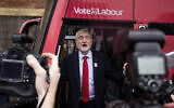 Britain's Labour Party leader Jeremy Corbyn unveils the Labour battle bus while on the general election campaign trail in Liverpool, England, Thursday Nov. 7, 2019. (Jacob King/PA via AP)
