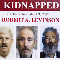 In this March 6, 2012, file photo, an FBI poster showing a composite image of former FBI agent Robert Levinson, right, of how he would look like now after five years in captivity, and an image, center, taken from the video, released by his kidnappers, and a picture before he was kidnapped, left, displayed during a news conference in Washington.  (AP Photo/Manuel Balce Ceneta)