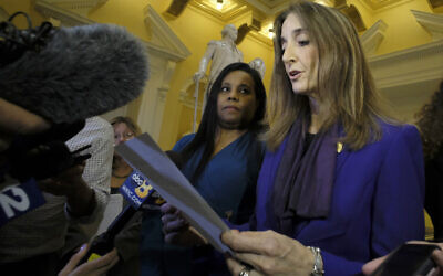 Del. Charniele Herring (D-Alexandria), left, and House Minority Leader Eileen Filler-Corn, right, speak to the media at the rotunda inside the State Capitol in Richmond, Virginia, February 21, 2019 (Bob Brown/Richmond Times-Dispatch via AP, File)