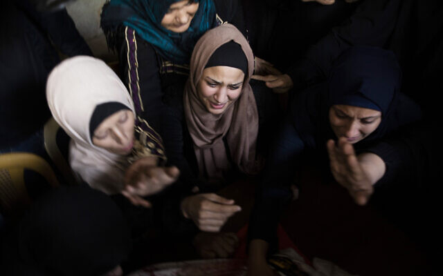 Relatives of Islamic Jihad terrorist Abdullah Al-Belbesi, 26, who was killed in Israeli airstrikes, at his funeral in the town of Beit Lahiya, northern Gaza Strip, November 13, 2019. (AP Photo/Khalil Hamra)