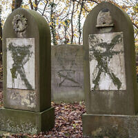 Tombstones vandalized at the Jewish cemetery in Randers, Denmark, November 10, 2019. (Bo Amstrup/Ritzau Scanpix via AP)