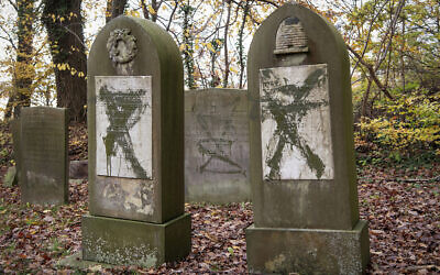 Tombstones vandalized at the Jewish cemetery in Randers, Denmark, November 10, 2019. (Bo Amstrup/Ritzau Scanpix via AP)