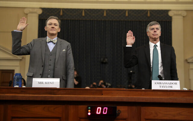Career Foreign Service officer George Kent and top US diplomat in Ukraine William Taylor, right, are sworn in to testify during the first public impeachment hearing of the House Intelligence Committee on Capitol Hill, November 13, 2019 in Washington. (AP Photo/Andrew Harnik)