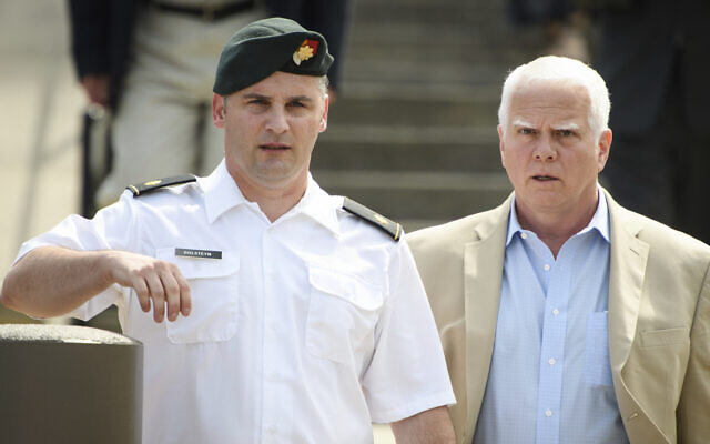 In this June 27, 2019, file photo. Maj. Mathew Golsteyn, a former Army Special Forces soldier, leaves the Fort Bragg courtroom facility with his civilian lawyer, Phillip Stackhouse, right, after an arraignment hearing. (Andrew Craft/The Fayetteville Observer via AP)