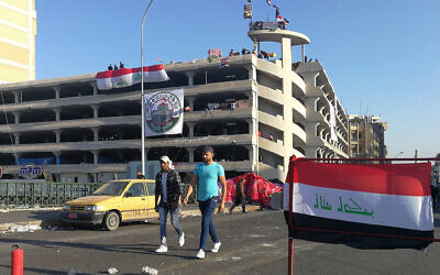 Anti-government protesters gather near the Sinak bridge leading to the Green Zone government areas during ongoing protests, in Baghdad, Iraq, November 17, 2019. (AP Photo/Khalid Mohammed)