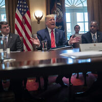 US Secretary of Veterans Affairs Robert Wilkie, left, and Secretary of Housing and Urban Development Ben Carson, right, listen as President Donald Trump speaks during a cabinet meeting at the White House, November 19, 2019, in Washington. (AP Photo/ Evan Vucci)