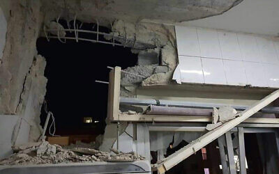 In this photo released by the Syrian official news agency SANA, a damaged building targeted by Israeli missile strikes is seen in Qudsaya suburb, western the capital Damascus, Syria, Wednesday, Nov. 20, 2019.  (SANA via AP)
