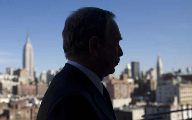 In this Jan. 31, 2008 file photo, New York Mayor Michael Bloomberg is silhouetted against a New York skyline.  (AP Photo/Mark Lennihan, File)