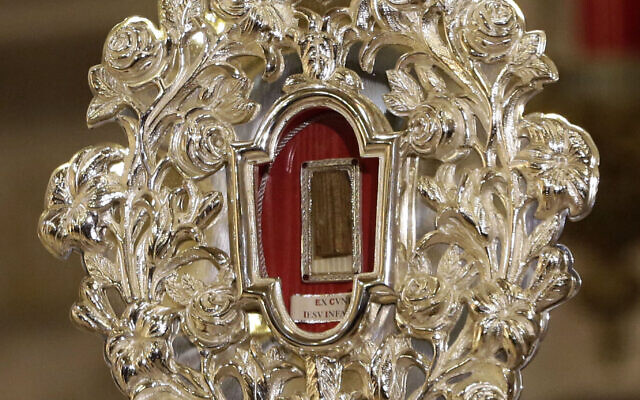 A wooden relic believed to be from Jesus' manger is seen at the Notre Dame church in Jerusalem, Friday, Nov. 29, 2019. Christians are celebrating the return to the Holy Land of a tiny wooden relic believed to be from Jesus' manger nearly 1,400 years after it was sent to Rome as a gift to the pope. (AP Photo/ Mahmoud Illean)