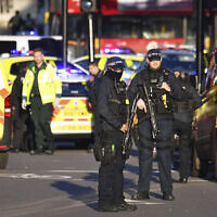 Armed police at the scene of a stabbing incident on London Bridge in central London, Friday, Nov. 29, 2019 (Dominic Lipinski/PA via AP)