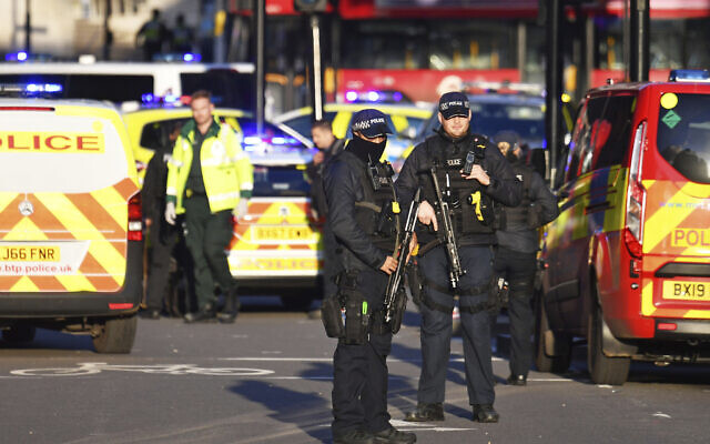 Armed police at the scene of a stabbing incident on London Bridge in central London, Friday, Nov. 29, 2019 (Dominic Lipinski/PA via AP)
