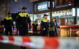 Dutch police secure a shopping street after a stabbing incident in the center of The Hague, Netherlands, November 29, 2019. (AP Photo/ Phil Nijhuis)