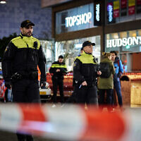 Dutch police secure a shopping street after a stabbing incident in the center of The Hague, Netherlands, Friday, Nov. 29, 2019 (AP Photo/Phil Nijhuis)