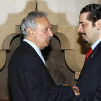 File: Saad Hariri, right, speaks with then-transportation minister Mohammad Safadi at the French ambassador's residence in Beirut, Lebanon, July 29, 2007. (AP Photo/Marwan Naamani, Pool)