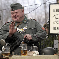 Illustrative: A member of historical military clubs wearing Nazi German uniform speaks prior to a World War II battle reconstruction during a military show 50 km (31 miles) north of Novgorod, Russia, Sunday, April 9, 2017. (AP/Dmitri Lovetsky)