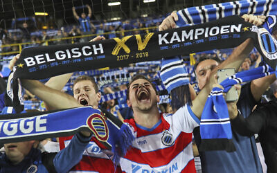 Illustrative: Club Bruges fans cheer prior to a Champions League soccer game at the Jan Breydel Stadium in Bruges, Belgium, September 18, 2018. (Francisco Seco/AP)