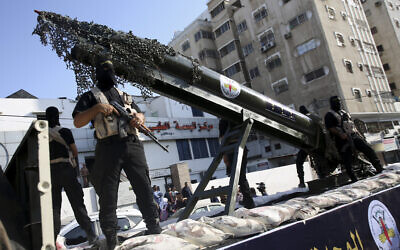 Palestinian members of the Al-Quds Brigades, the military wing of the Islamic Jihad terrorist group, parade with a replica rocket on a truck during a march to show loyalty for the Iranian-backed Palestinian movement's newly elected leader Ziad al-Nakhalah during a rally along the streets of Gaza, Thursday, Oct. 4, 2018. (AP Photo/Adel Hana)