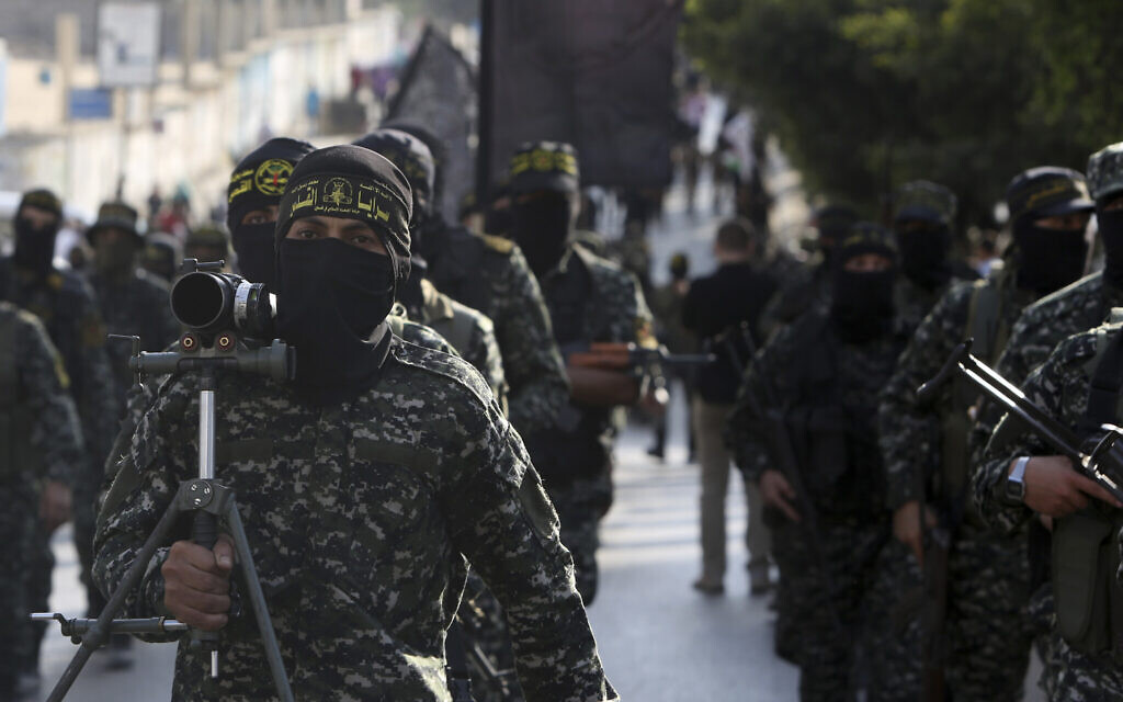 Members of the Al-Quds Brigades, the military wing of the Islamic Jihad terrorist group, march with their weapons to show loyalty for the Iranian-backed Palestinian movement's newly elected leader Ziad al-Nakhalah during a rally in Gaza, October 4, 2018. (AP Photo/Adel Hana)