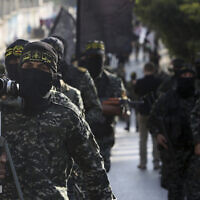 Palestinian members of the Al-Quds Brigades, the military wing of the Islamic Jihad terrorist organization, march with their weapons to show loyalty for the Iranian-backed Palestinian movement's newly elected leader Ziad al-Nakhalah during a rally along the streets of Gaza,, October 4, 2018. (AP Photo/Adel Hana)