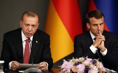 Turkey's President Recep Tayyip Erdogan, left, sits by French President Emmanuel Macron during a news conference following a summit on Syria, in Istanbul, Saturday, Oct. 27, 2018. (AP Photo/Lefteris Pitarakis)