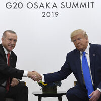 Illustrative: US President Donald Trump, right, shakes hands with Turkish President Recep Tayyip Erdogan, left, during a meeting on the sidelines of the G-20 summit in Osaka, Japan, June 29, 2019. (Susan Walsh/AP)