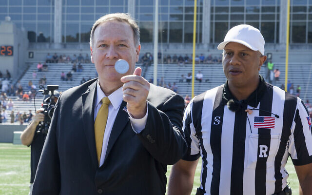 U.S. Secretary of State Mike Pompeo flips a coin to at the start of an NCAA college football game between the Army and Morgan State, Saturday, Sept. 21, 2019 in West Point, N.Y. (AP/Julius Constantine Motal)