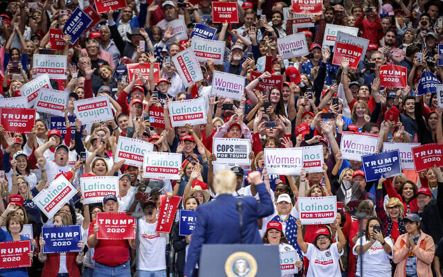 US President Donald Trump greets supporters as he walks on stage during a campaign rally, Thursday, Oct. 17, 2019, at the American Airlines Center in Dallas. (AP Photo/Jeffrey McWhorter)