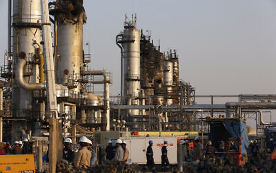 In this September 20, 2019, file photo, taken during a trip organized by Saudi information ministry, workers fix the damage in Aramco's oil separator at processing facility after the Sept.ember 14 attack in Abqaiq, near Dammam in the Kingdom's Eastern Province (AP Photo/Amr Nabil, File)