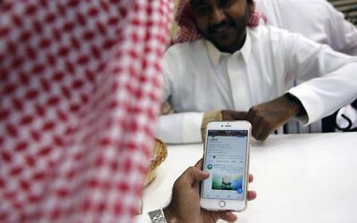 Illustrative: A man reads Twitter at a coffee shop in Jiddah, Saudi Arabia, Sunday, Nov. 3, 2019.  (AP Photo/Amr Nabil)