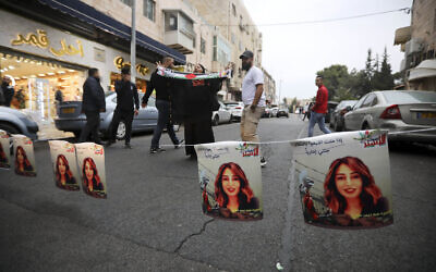 Palestinians hang photos of Heba al-Labadi, a Jordanian citizen of Palestinian descent, during a protest demanding her release in East Jerusalem on Oct. 26, 2019. (AP/Mahmoud Illean)