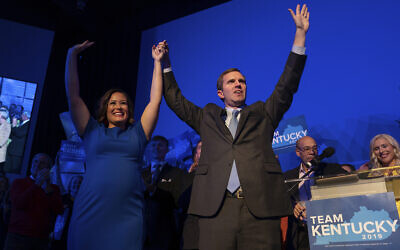 Democratic gubernatorial candidate and Kentucky Attorney General Andy Beshear, along with lieutenant governor candidate Jacqueline Coleman, acknowledge supporters at the Kentucky Democratic Party election night watch event, Nov. 5, 2019, in Louisville, Ky. (AP Photo/Bryan Woolston)