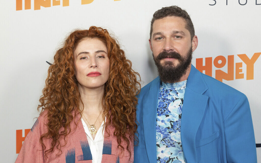"""Alma Har'el, left, and Shia LaBeouf arrive at the LA Premiere of """"Honey Boy"""" at the ArcLight Hollywood on November 5, 2019, in Los Angeles. (Photo by Willy Sanjuan/Invision/AP)"""